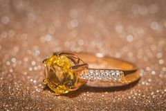 Gold ring with citrine. Yellow gold ring with shining citrine gemstone stock photos