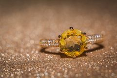 Gold ring with citrine. Yellow gold ring with shining citrine gemstone stock photo