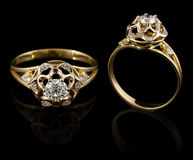 Gold ring with diamond. On black Royalty Free Stock Images