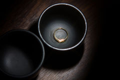 Gold ring with diamond. Gold ring with a diamond engagement in a vase Stock Photo