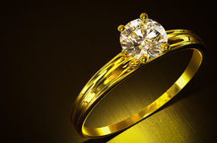 Gold ring with diamond. Royalty Free Stock Photos