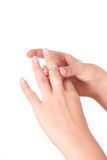 Gold ring with a diamond on a female hand Royalty Free Stock Photography