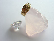 Gold ring and diamonds. A gold ring and a large diamond Stock Image