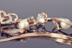Free Gold Ring, Earrings And Chains Royalty Free Stock Photo - 65235555