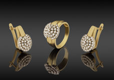 Gold ring and earrings with diamonds Stock Photography