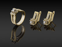 Gold ring and earrings with diamonds Royalty Free Stock Image