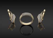 Gold ring and earrings with diamonds Stock Photos