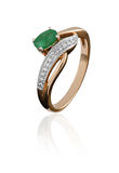 Gold ring with an emerald. And diamond  on white Royalty Free Stock Photography