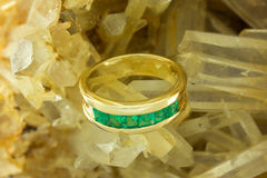 Gold ring with emeralds Royalty Free Stock Photo