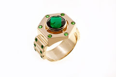 gold ring with emeralds Stock Images