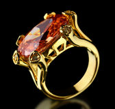 Gold ring with gem on a black stock photography