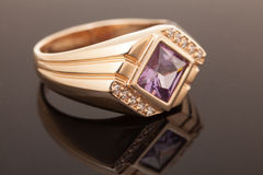 Gold ring with gem. Fashion Jewelry background Stock Image