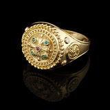 Gold ring with gems. On black background Royalty Free Stock Photography