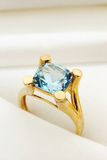 Gold Ring with Gemstone. Gold ring in giftbox with blue gemstone Stock Photo