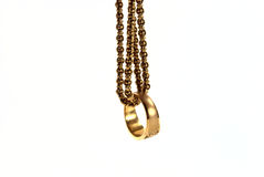 Gold ring with gold chain Stock Images