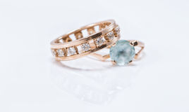 Gold ring with light Topaz and a thick ring with diamonds Stock Photos
