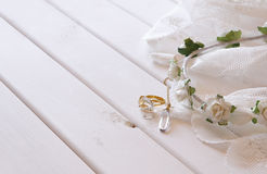 Gold ring and necklace and white floral tiara. On toilette table. Selective focus Stock Image
