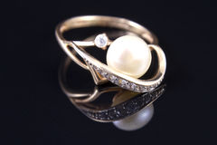 Gold ring with a pearl Royalty Free Stock Image