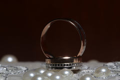 Gold ring and pearl beads Stock Photography