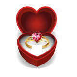 Gold ring with pink heart gemstone. Stock Image
