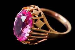 Gold ring with pink stone Stock Images