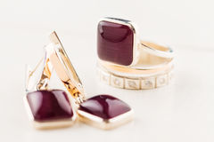 Gold ring with purple gemstone Stock Photos