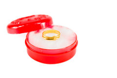 Gold ring on red box Royalty Free Stock Images