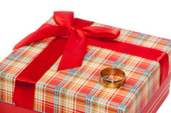 Gold ring on the red box for a gift with a bow Royalty Free Stock Images