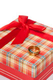 Gold ring on the red box for a gift with a bow Royalty Free Stock Photo