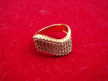 Gold ring on red surface. Gold ring placed on red surface royalty free stock images