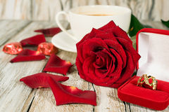 Gold ring , a rose and a cup of coffee Royalty Free Stock Image