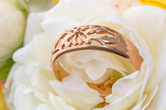 Gold ring in rose petals Royalty Free Stock Photography