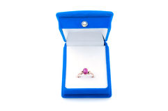 Gold ring with ruby in blue velvet jewelry box Stock Image