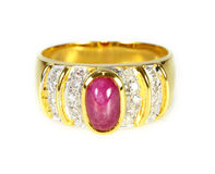 Gold ring with ruby and diamond Stock Photo