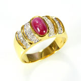 Gold ring with ruby and diamond Royalty Free Stock Photos