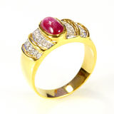 Gold ring with ruby and diamond Stock Image