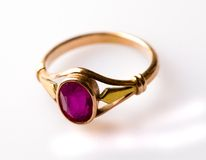 Gold ring with ruby isolated on white background Royalty Free Stock Photos