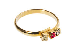 Gold ring with a ruby and two diamonds. Stock Photography