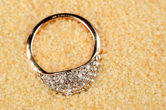 Gold Ring on Sand Stock Photos