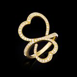Gold ring in the shape of heart Stock Image