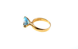 Gold ring with a topaz Royalty Free Stock Images