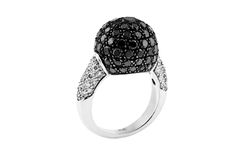Gold ring with white and black diamonds Royalty Free Stock Photo