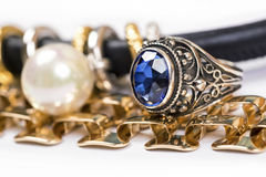 Gold rings,blue sapphire jewelry and pearl Royalty Free Stock Image