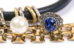 Gold rings,blue sapphire jewelry and pearl Stock Photos