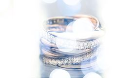 Gold rings and bokeh. Ring diamond white precious gem decoration single object Stock Photography