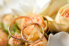 Gold rings on a bouquet of roses Royalty Free Stock Photo