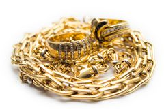 Gold rings and chains Stock Photos