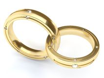 Gold rings with diamonds. Two gold rings with diamonds stock photos