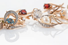 Gold rings, earrings with Topaz and pearls Stock Image