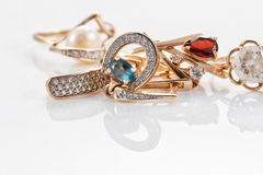 Gold rings, earrings with Topaz and pearls Royalty Free Stock Photo